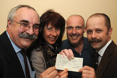 Rod Littlewood, Andy Nelson and Steve Parsons present £1000 to Gail Maguire
