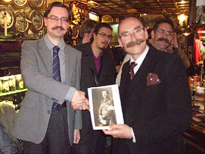 Helsinki University Moustache Club President, Alex presents Handlebar Club Scribe Tom Cutler with an archive photo of Baron Carl Gustaf Mannerheim - Click to enlarge
