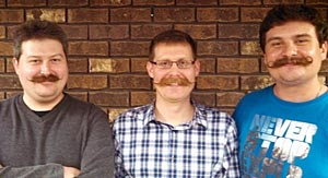 Triumphantly Moustached - The Brothers Theriault L to R: Aaron, Bryan and Mark - Click to enlarge